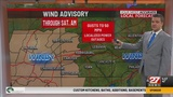Stray showers linger today, turning windy too